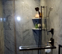 marble-shower-with-heavy-glass-doors-stow-ma