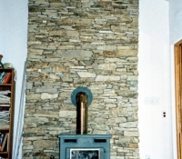 connecticut-tan-flatstone-chimmney-with-wood-stove-stow-ma